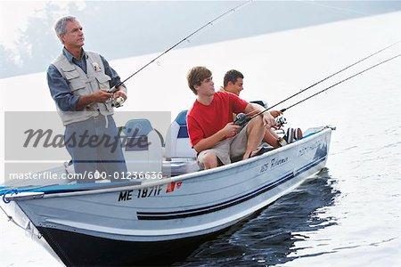 Man and Teenagers Fishing, Belgrade Lakes, Maine, USA