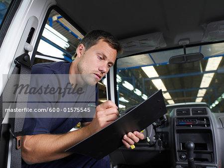 Man Inspecting Car
