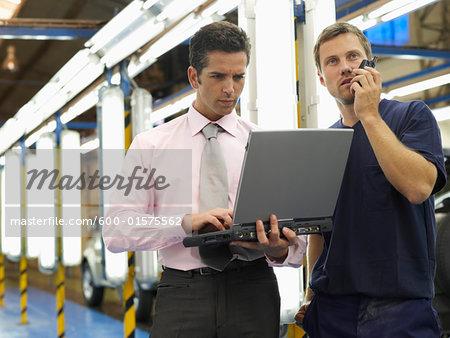 Men in Automotive Plant