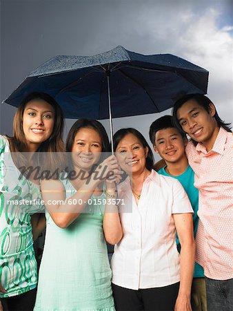 Portrait of Mother with Children in Rain