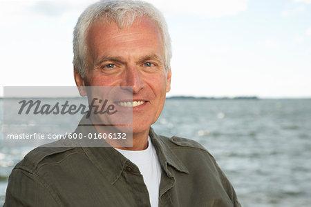Portrait of Man by Water