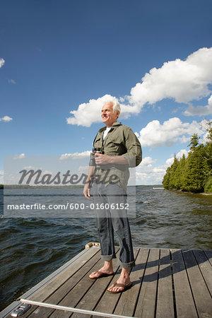 Man with Binoculars by Lake