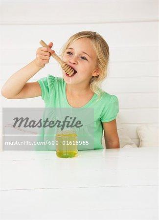 Little Girl Eating Honey