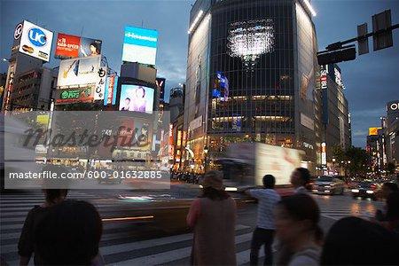 People Waiting to Cross Street at Shibuya Station, Tokyo, Japan
