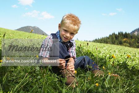 Boy Tying his Shoelaces