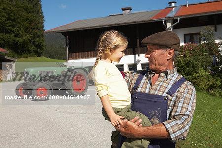 Farmer Holding Girl