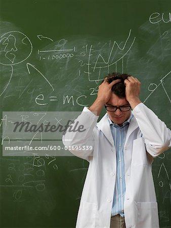 Confused Scientist in Front of Blackboard