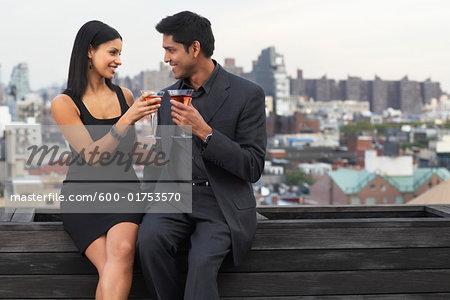Couple Drinking Wine on Balcony, Soho, New York City, New York, USA