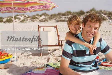 Father and Son on Beach, Majorca, Spain