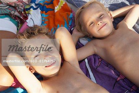 Brothers Lying on Beach Blanket, Majorca, Spain