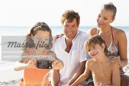 Girl Taking Portrait of Family on Beach, Majorca, Spain