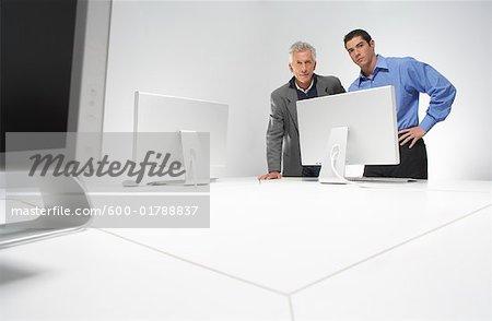 Businessmen Looking at Computer Screen