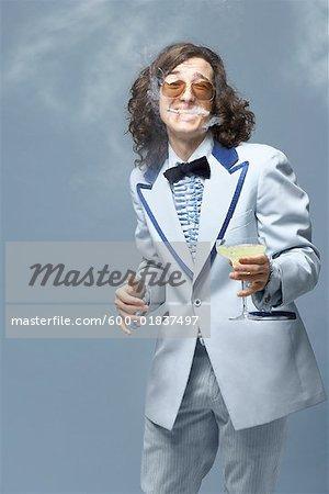 Portrait of Man Smoking, Holding Beverage