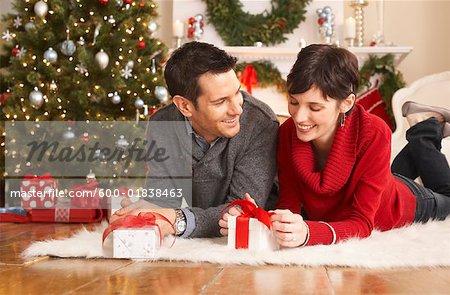 couple opening christmas presents stock photo