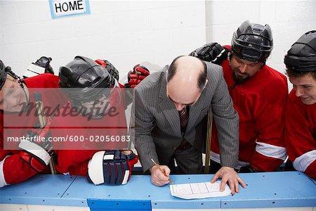 Coach Going Over Game Plan