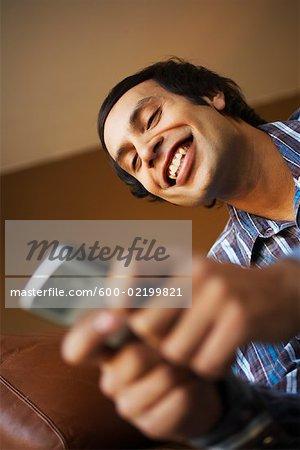 Man Using Electronic Organizer