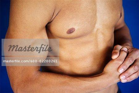 Close-up of Man Flexing Bicep
