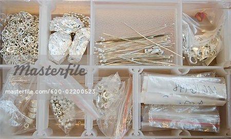 Close Up on Box of White Beads/ Jewelry