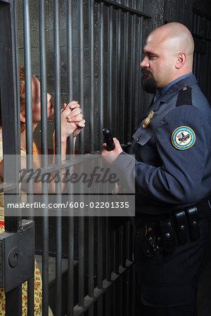 Woman Talking to Prison Guard