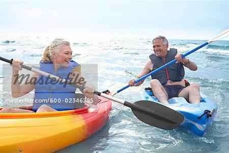 woman and man kayaking stock photo masterfile premium royalty