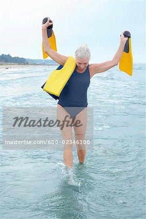 Woman Walking in Shallow Water