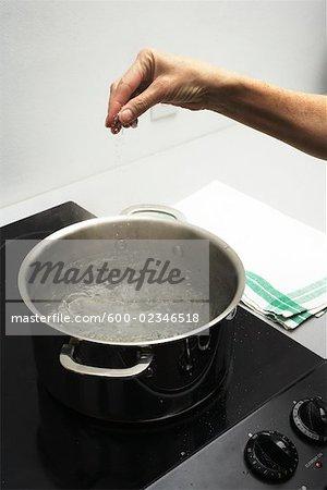 Hand Seasoning Boiling Water