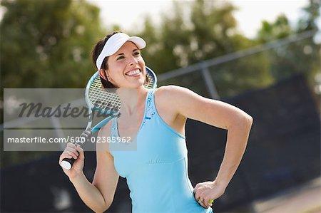 Portrait of Woman Holding Tennis Racquet