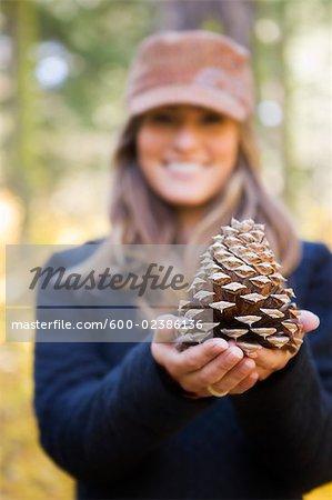Woman Holding Cone of Ponderosa Pine