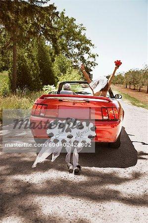 Newlyweds Driving Away in Convertible, Niagara Falls, Ontario, Canada