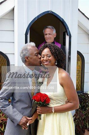 Groom Kissing Bride Outside Chapel, Niagara Falls, Ontario, Canada