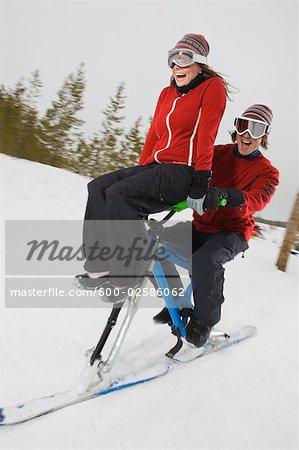 Couple Riding Skibikes, Near Frisco, Summit County, Colorado, USA