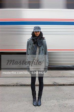 Woman Standing Near Speeding Train, Portland, Oregon, USA