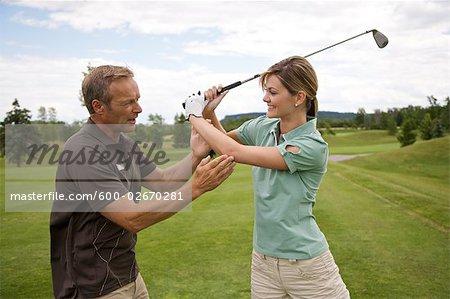 Woman Learning How to Golf, Burlington, Ontario, Canada