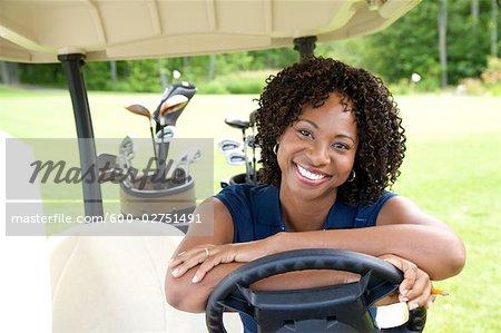 Portrait of Woman Sitting in Golf Cart