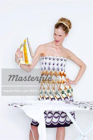 Woman Looking Angrily at Iron