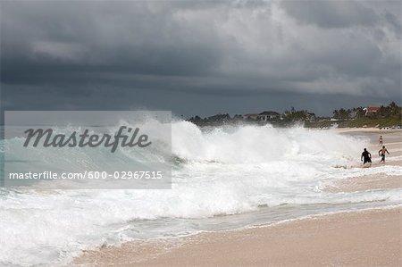 People Playing in Large Waves, Paradise Island, Bahamas
