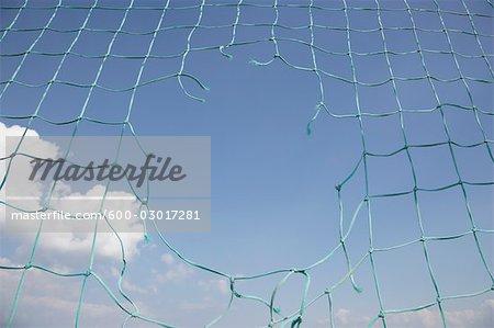 Hole in Soccer Net