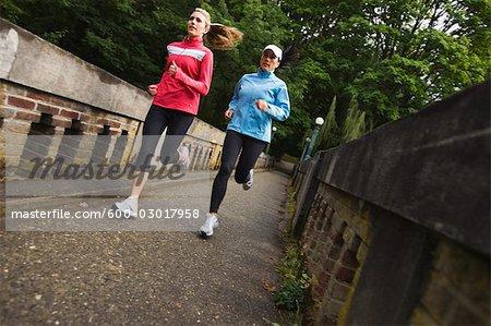 Women Running on Bridge in Arboretum, Seattle, Washington, USA