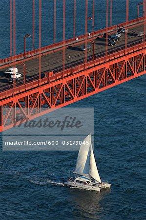 Sailboat Passing Under the Golden Gate Bridge, San Francisco, California, USA