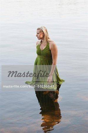 Woman Standing in Kahshe Lake, Muskoka, Ontario, Canada