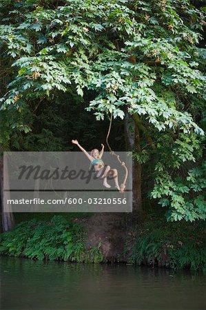 Teenage Girl Jumping Into Lake, Near Portland, Oregon, USA