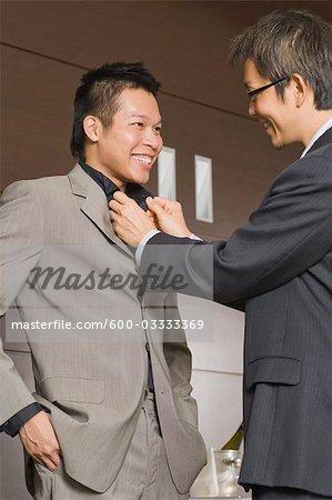 Man Adjusting Partner's Shirt Collar