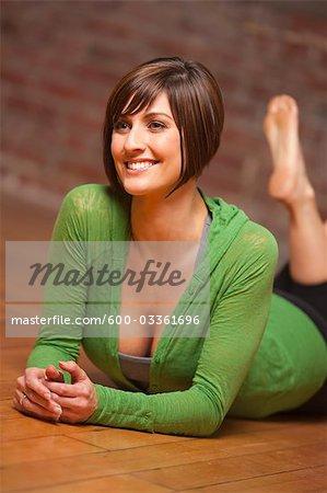 Happy Woman Lying on Floor