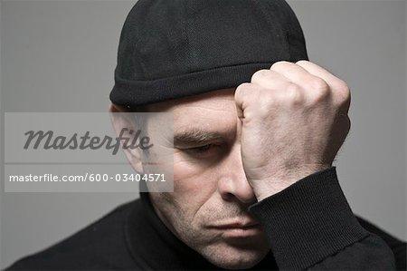 Portrait of Man in Black Cap
