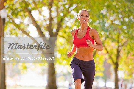 Woman Running in the Park, Seattle, Washington, USA