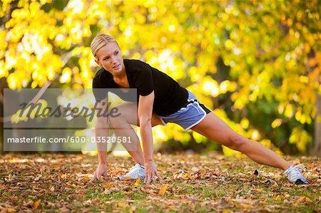 Woman Stretching After a Run, Seattle, Washington, USA