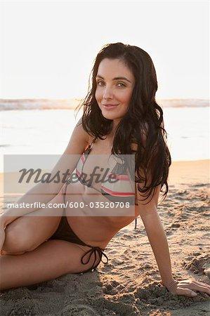 Portrait of Young Woman on Beach, Zuma Beach, California, USA
