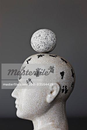 Rock Balancing on Model of Head