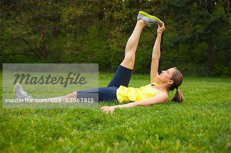 Woman Exercising in the Park, Portland, Oregon, USA