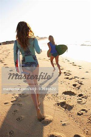 Women Holding Surfboards, Baja California Sur, Mexico